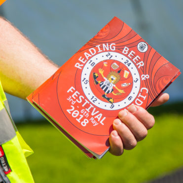 Reading Beer and Cider Festival 2018 programme held by a volunteer