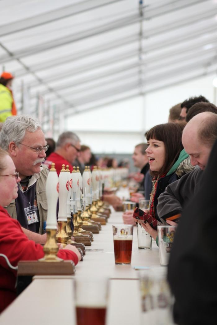 staff serving customers at the reading beer festival bar